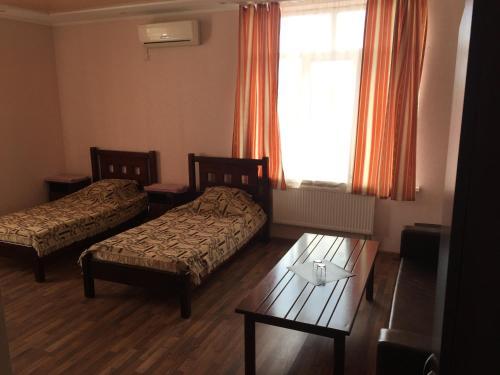 Кровать или кровати в номере Отель «Двин»