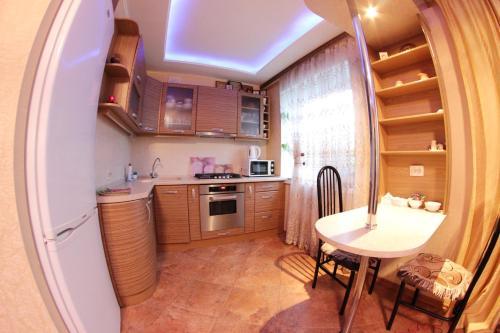 Кухня или мини-кухня в SweetHome Нововоронеж
