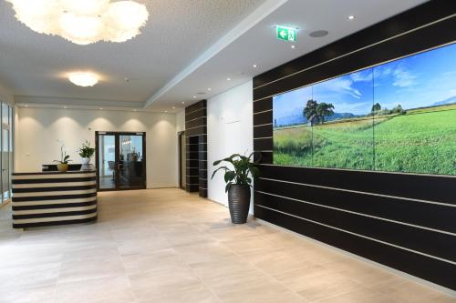 The lobby or reception area at Hotel kommod