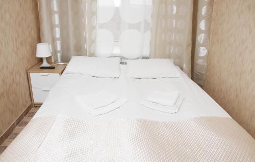 Кровать или кровати в номере PRESTO Невский 95/Гончарная 10