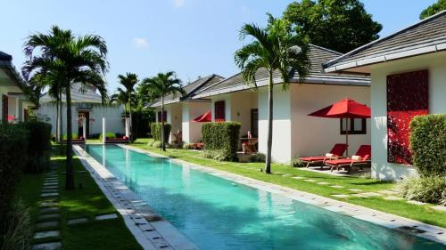 The swimming pool at or close to Rouge - Villas & Spa