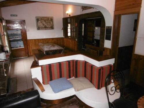 A seating area at Hostel La Casa de Tounens