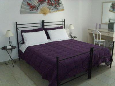 A bed or beds in a room at B&B Emmanuel