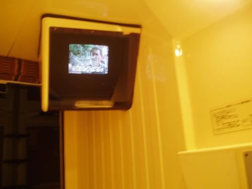 A television and/or entertainment center at Capsule Hotel & Sauna Ikebukuro Plaza