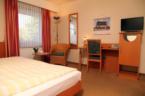 Ein Zimmer in der Unterkunft Ringhotel Paulsen
