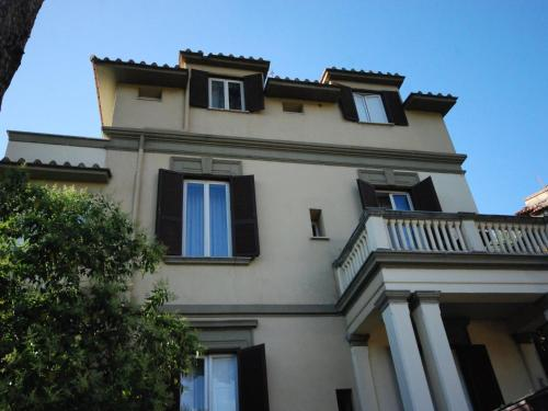 The facade or entrance of Hotel Residence Villa Tassoni