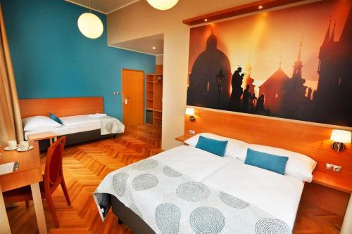 Cama o camas de una habitación en Hotel Adler