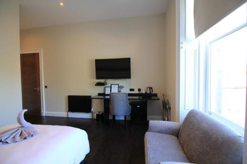 A television and/or entertainment center at Western Guest House