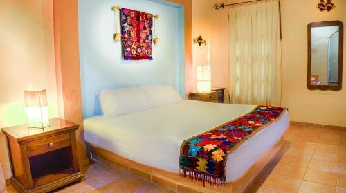 A room at Hotel Casa de las Flores