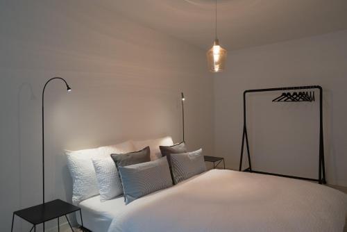 Ein Bett oder Betten in einem Zimmer der Unterkunft Paradeplatz Apartment by Airhome