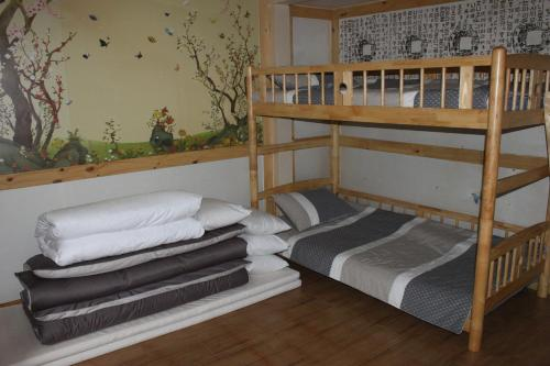 A bunk bed or bunk beds in a room at Charm Hanok Guest House