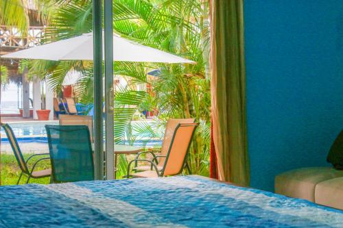 A bed or beds in a room at Sabas Beach Resort