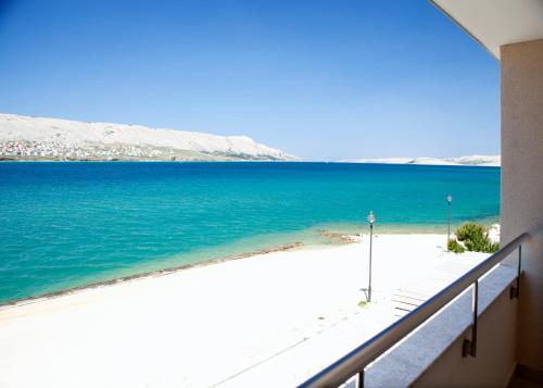 A balcony or terrace at Family Hotel Pagus - All Inclusive