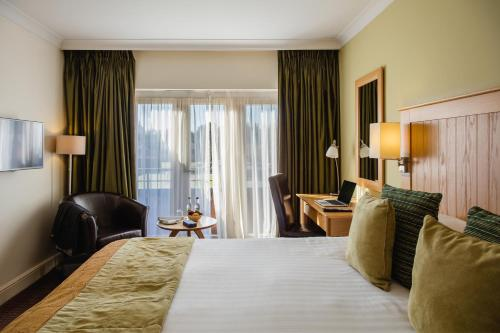 A bed or beds in a room at Mercure Warwickshire Walton Hall Hotel & Spa
