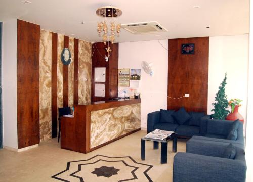 The lobby or reception area at Hotel Apaar