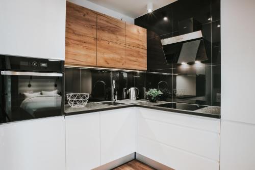 Kuchnia lub aneks kuchenny w obiekcie Mia Apartments