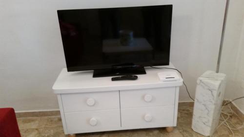 Una televisión o centro de entretenimiento en Appartamento Rifredi