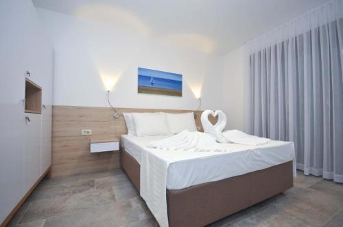 Кровать или кровати в номере Corso Levante Luxury Suites