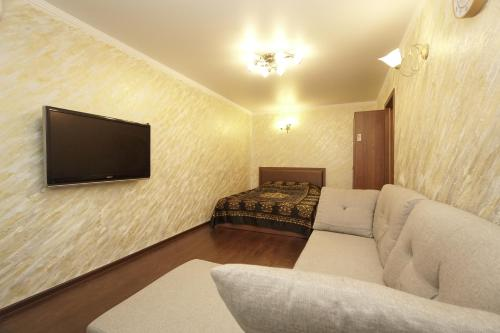 A bed or beds in a room at Lenina 1G Apartment
