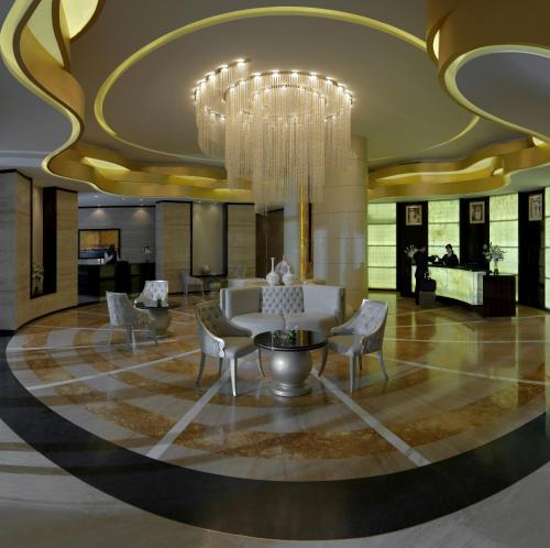 The lobby or reception area at DAMAC Maison Cour Jardin