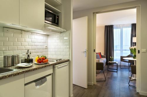 A kitchen or kitchenette at Citadines Montmartre Paris