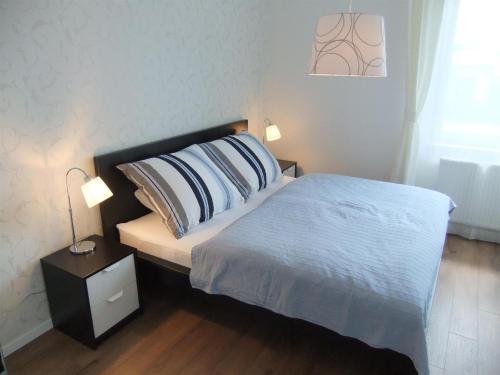 Ліжко або ліжка в номері ELEGANT apartmán ajaj