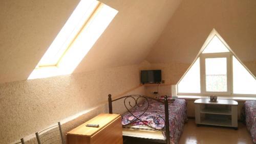 Кровать или кровати в номере Mini-Otel Garibaldi