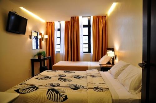 A bed or beds in a room at Silverstar Hotel