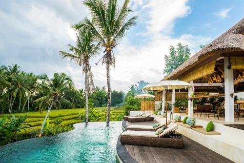 A porch or other outdoor area at Calma Ubud Suite & Villas