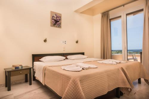 Huone majoituspaikassa Mythos Beach Hotel Apartments