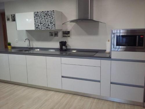 A kitchen or kitchenette at Casa abuela Gaspara I