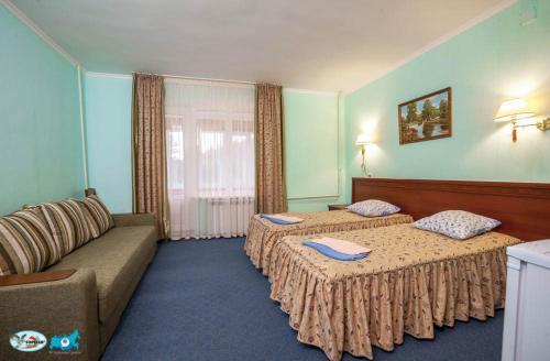 Кровать или кровати в номере Турбаза Лаго-Наки
