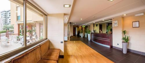 The lobby or reception area at Hotel Residence Ulivi E Palme