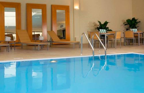 The swimming pool at or near DoubleTree by Hilton Hotel and Conference Center Chicago North Shore