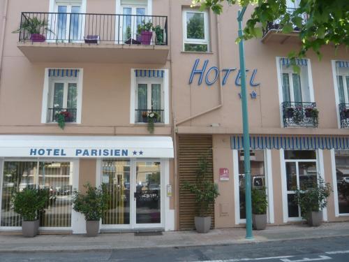 The facade or entrance of Hotel Parisien