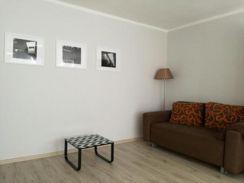 Ein Sitzbereich in der Unterkunft Apartament Arkońska