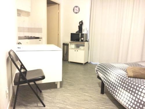 A room at Coquet Studio Fonctionnel