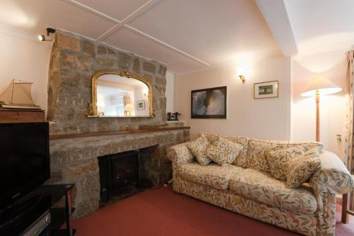 The lounge or bar area at Post Box Cottage
