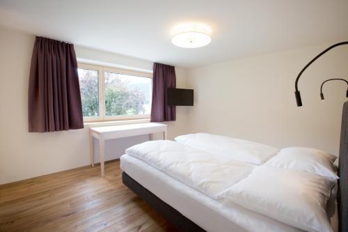 Ein Bett oder Betten in einem Zimmer der Unterkunft Schtûbat (Contactless Check-In)