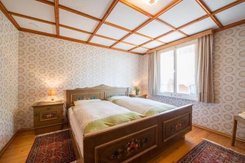 A bed or beds in a room at Gasthof Kreuz Bildstein