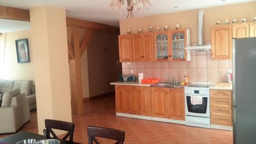 Kuchnia lub aneks kuchenny w obiekcie Apartament Mikołajki
