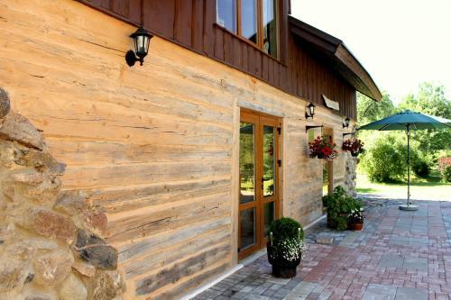 A porch or other outdoor area at Sveču darbnīca Bandeniekos