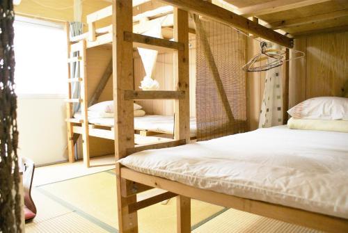 民宿 アガイ浜にあるベッド