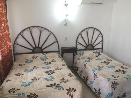 A bed or beds in a room at Hotel Posada del Angel