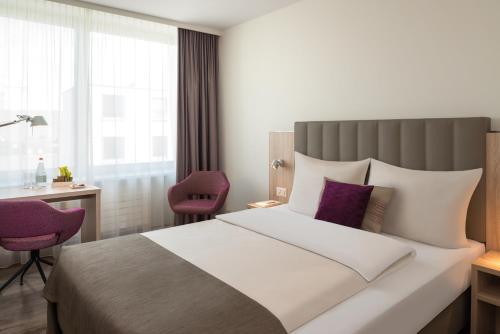 Una habitación en Dorint Hotel Basel