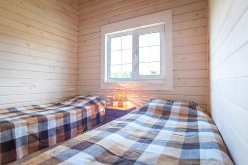 Кровать или кровати в номере Старый Сиг