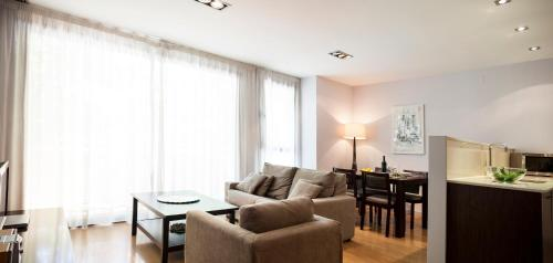 The lounge or bar area at Short Stay Group Camp Nou Serviced Apartments