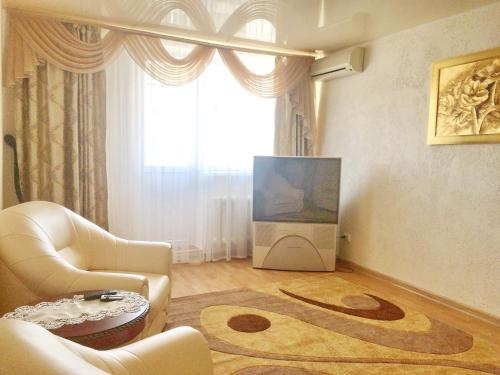 A seating area at Apartment with Sea View near Park Shevchenko