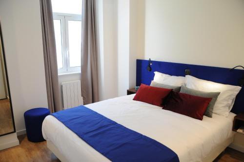 Cama o camas de una habitación en Lisbonne Appartements