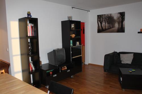 Гостиная зона в Sunny Two-story Apartment Kyje